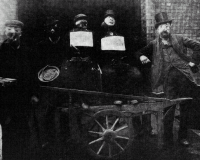 Guy Fawkes effigies and collectors, all masked, 1903, by John Benjamin Stone.